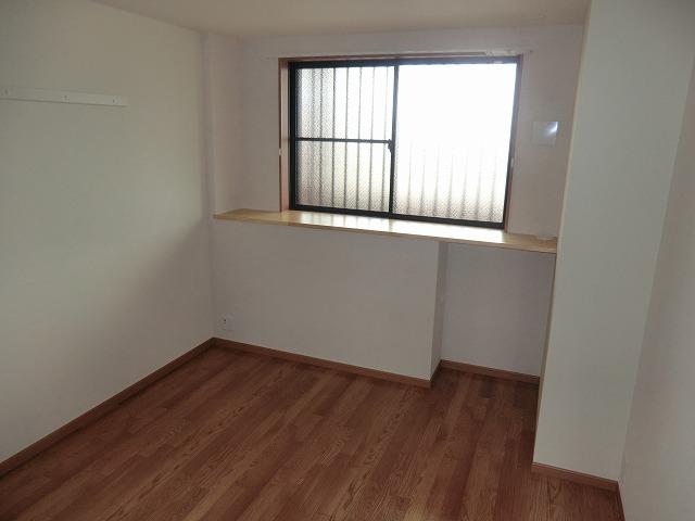 アシューレ・M 105号室のベッドルーム
