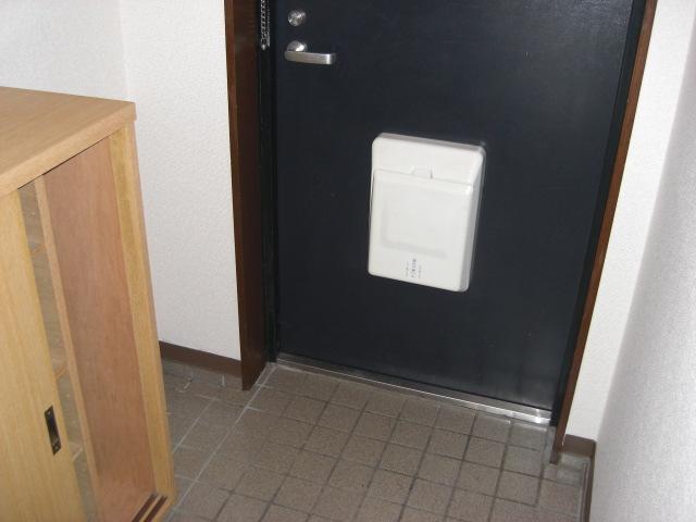 フユーグマンション 207号室の玄関