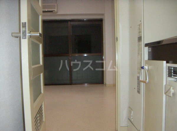 メゾン塚本 404号室の玄関