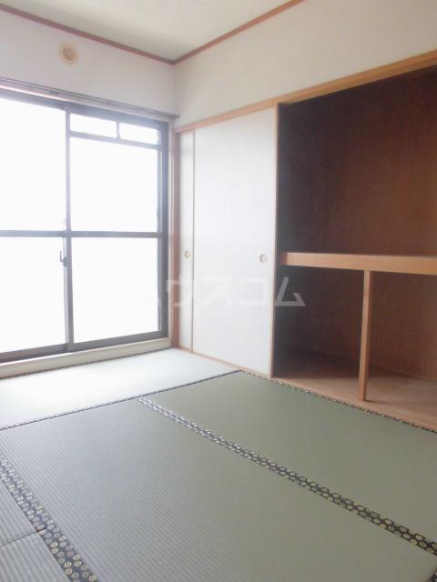 ガーデンパレスカネブン A 201号室の居室