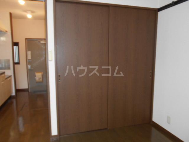 プチハウス 1-A号室のベッドルーム
