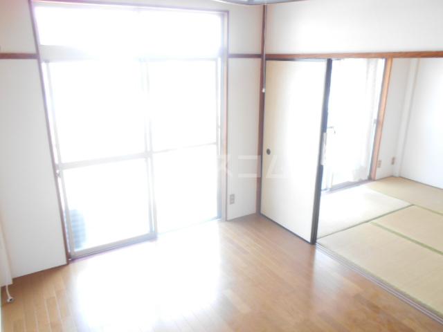 ニューサンシャインホリコシ 303号室の居室