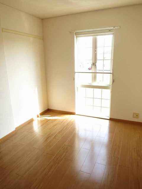 グランデールA 202号室のベッドルーム
