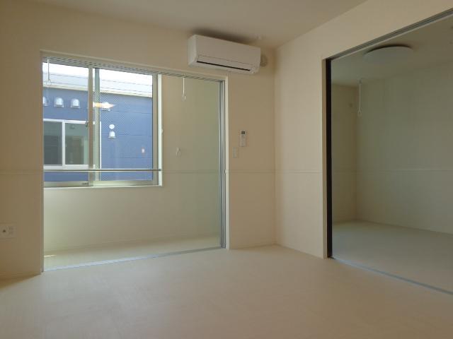 コンフォーレ・K 203号室の居室