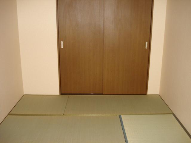ウィング富士A 302号室のベッドルーム