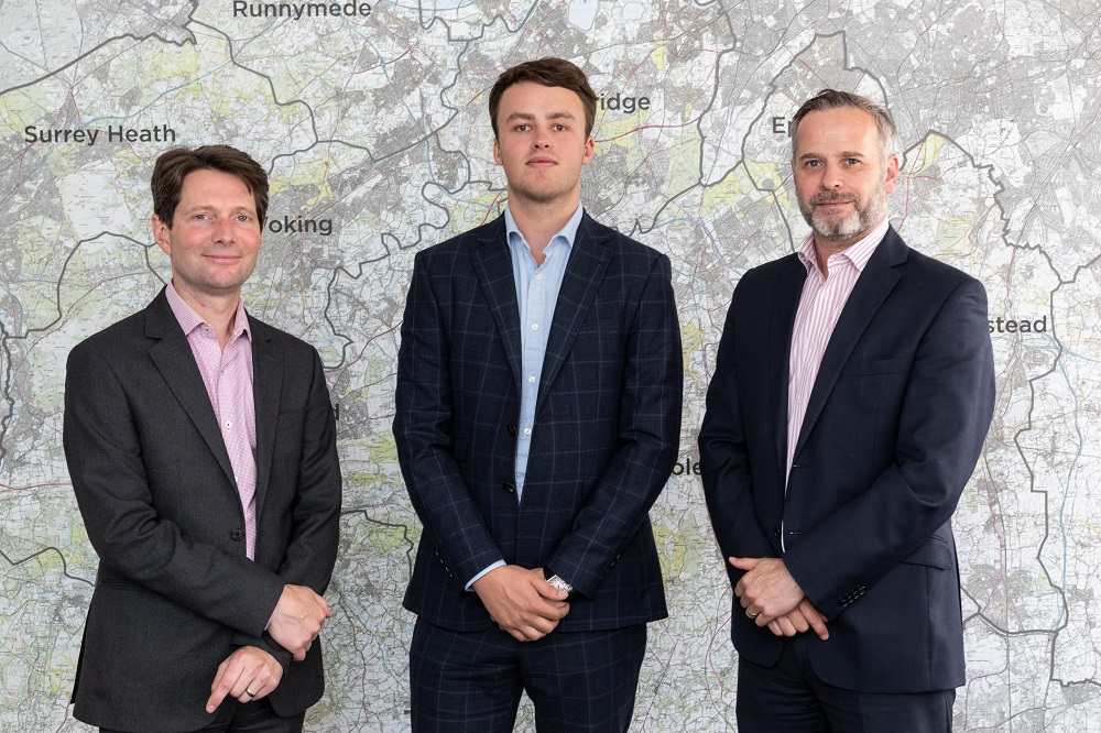 Pictured (centre) Elliot McNish, recently promoted to Surveyor Level 2 - smaller