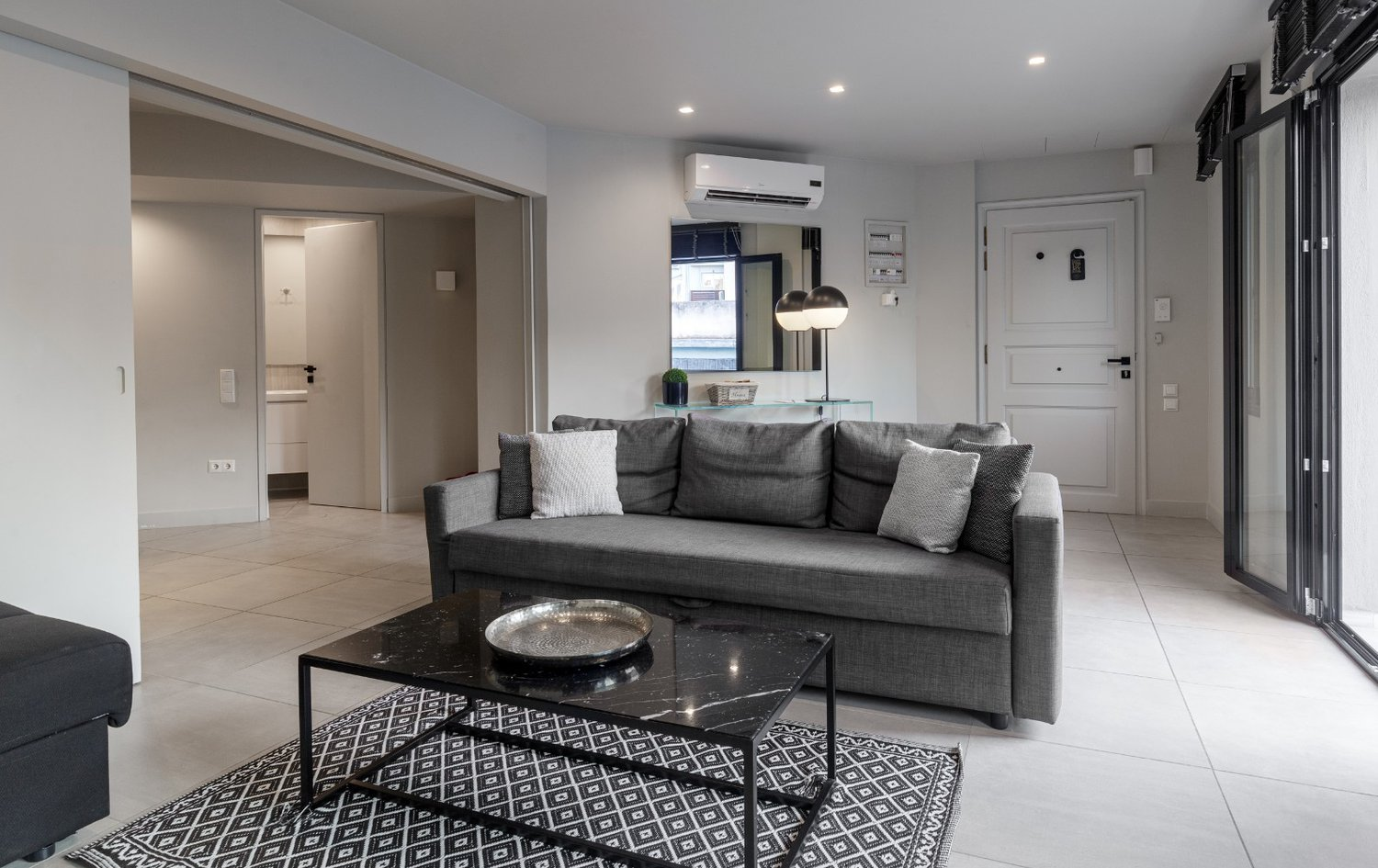 The Bedroom and the Living Room in Premier Suite - Heart of Athens