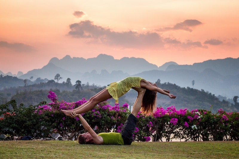 two people doing yoga together symbolizing sales and marketing alignment