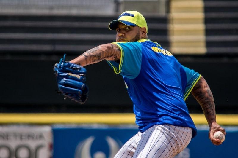 Man throwing a baseball