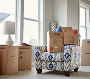 Moving boxes stacked around a living room