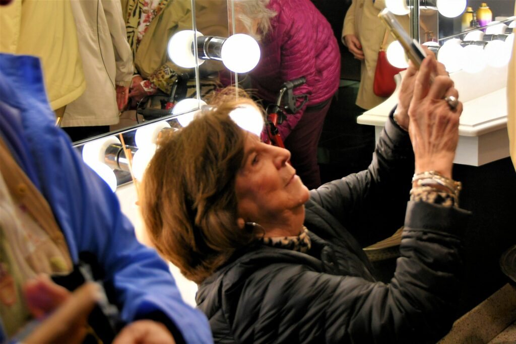 Peggy Turnage gets creative to get just the right angle for her shot in the Sinema ladies room.