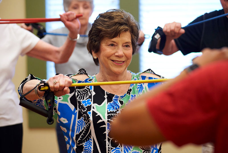 A class of seniors work with resistance bands for bone strengthening exercises
