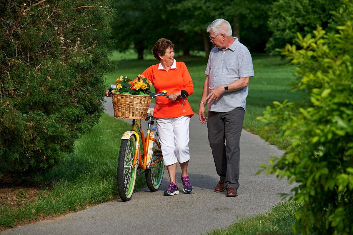 Senior couple on a walk outside their retirement community