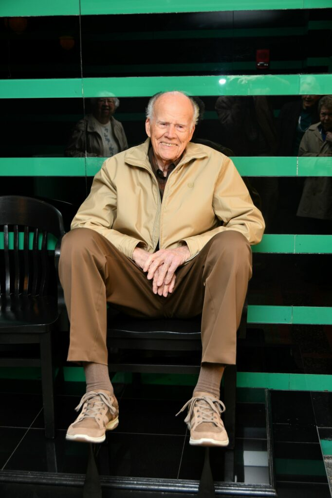 Gordon Heckle looks comfy sitting on a shoe-shine chair in The Hermitage mens room.