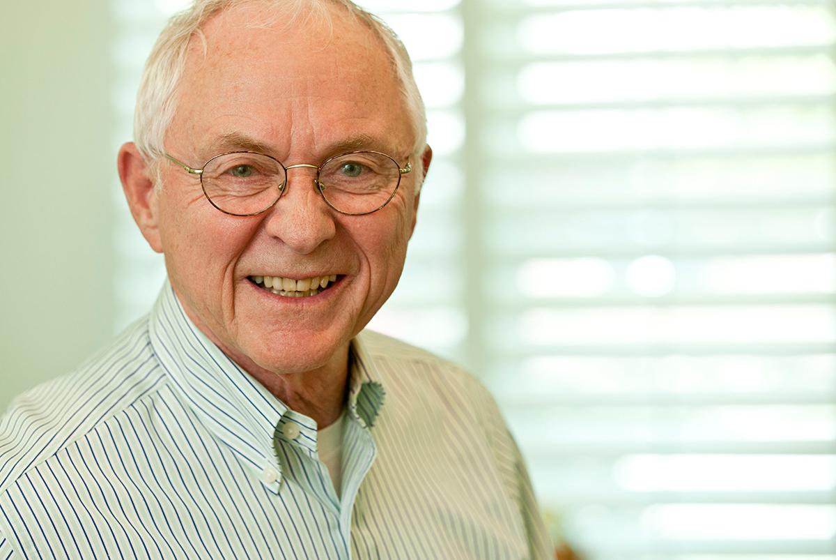 Older gentleman smiling at camera