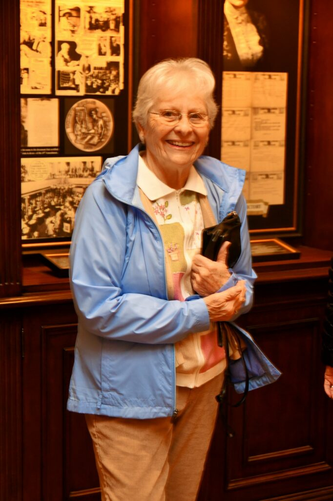 Sylvia Baldwin poses in front of displays illustrating The Hermitage Hotel storied history.