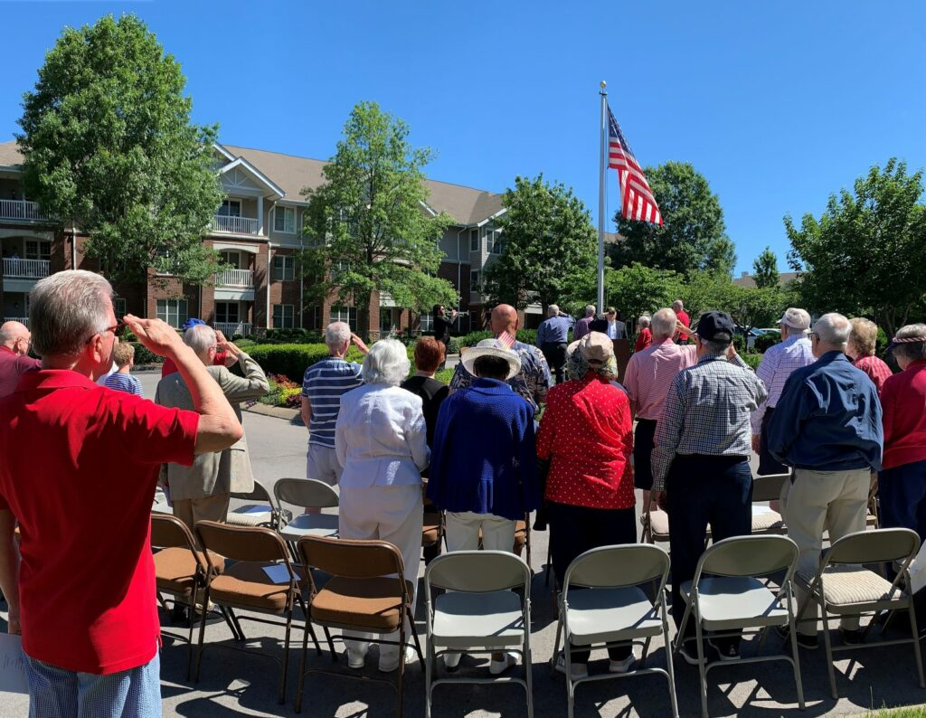Veterans salute during the Pledge of Allegiance Monday at The Heritage at Brentwood. Photo by Susan Leathers.