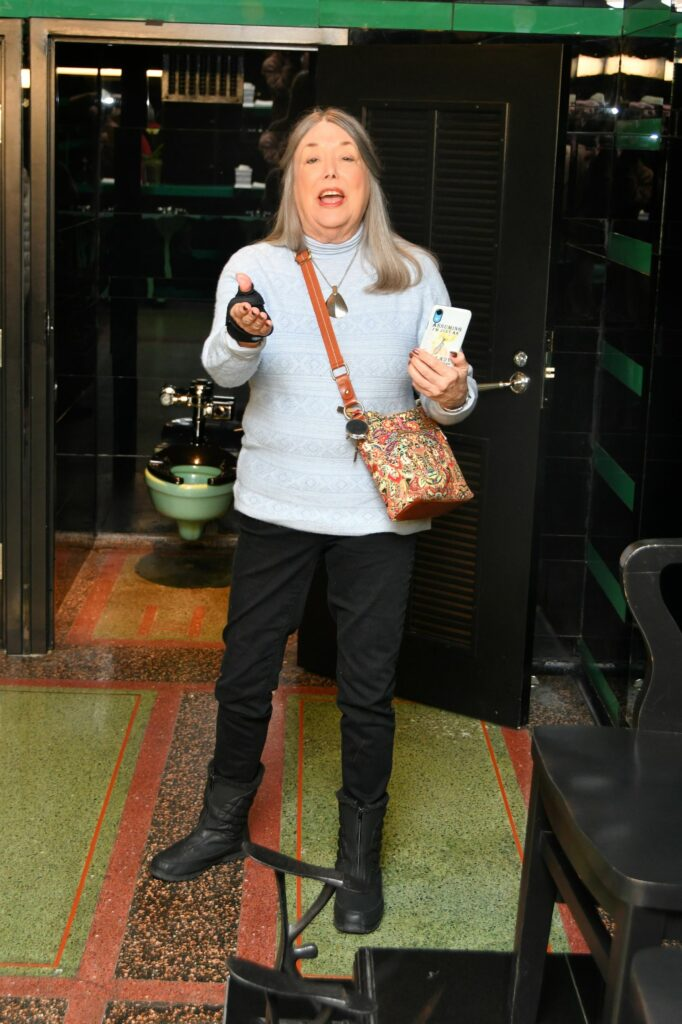 Barbara Rhodes seems to be saying, Come on in!