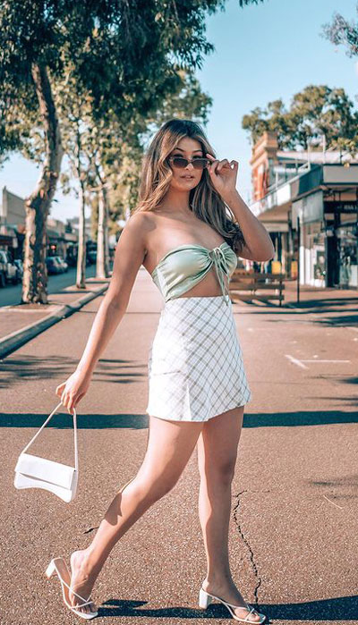 Mix and match your bandeau bikini top with a plaid mini skirt, spaghetti-heeled sandals, and a high-end white sling bag for a vacation-ready look!