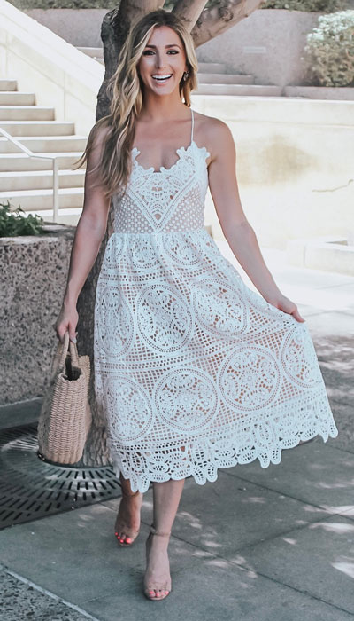 You will look divine in this boho style. A long lace white dress paired with your beachy tote and tan footwear is a must-have! 23 Summer Vacation Outfits To Make Your Next Trip Stylish