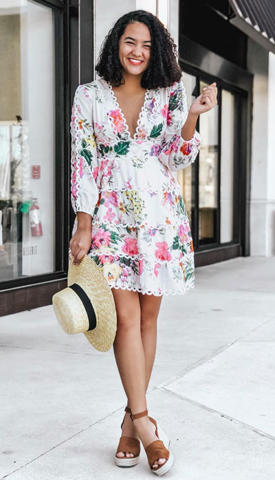 For your next trip, try wearing a V-neck floral dress with tiered scallop details. Don't forget to bring some beachy straw hats and wedge kicks to feel a little more special look. 23 Summer Vacation Outfits To Make Your Next Trip Stylish