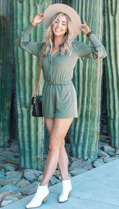 A jumpsuit is another great vacation piece as it can be dressed up or down. Add some white leather ankle boots and a taupe hat for a more summer vibe. 23 Summer Vacation Outfits To Make Your Next Trip Stylish