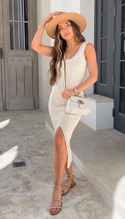 If you're looking for a comfortable vacation outfit that also happens to photograph well — then a ribbed knit bodycon dress, brown Panama hat, and clear studded flat sandals are your best bet.
