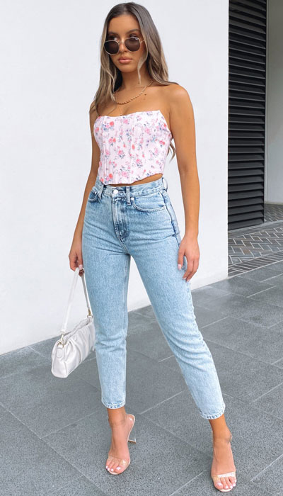 cropped length high-waisted denim is a perfect pair for any summery top just like this pink floral corset
