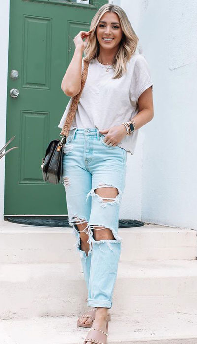 plain white loose tee and light wash distressed pants