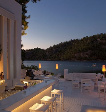 The perfect post-sunset perch for a glass of Champagne to the gentle sound of waves lapping the shore