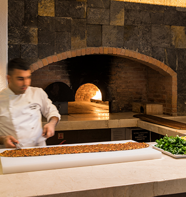 Turkish Chef Cooking Lahmacun At Hillside Beach Club