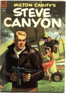 STEVE CANYON--DELL FOUR COLOR #519-TOMMY GUN COVER ART--1953