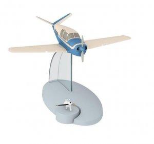 Avion Tintin con figura Milu: avion BEECHCRAFT 35 BONANZA del album El asunto...
