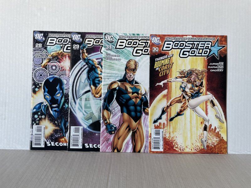 Booster Gold #28 29 30 & 31  (2009) Unlimited Combined Shipping