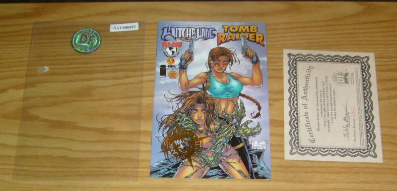 Witchblade/Tomb Raider #½ VF/NM dynamic forces gold logo variant w/ COA (2,500)