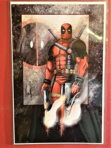 This is a print of Deadpool, signed by Norman Lee