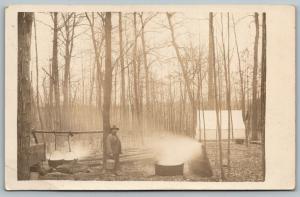 RPPC Man w/Bucket, Kettles & Half-Barrel A-Smokin'~Winter Campout Tent~c1916