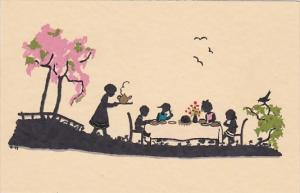 Silhouette Children Sitting At Table Eating