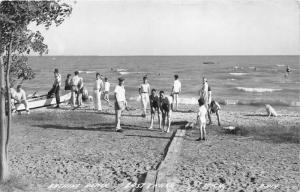 East Tawas Michigan~Bathing Beach Scene~People Posing~Dog~Boat~1940s RPPC
