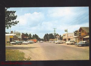 LAND O'LAKES WISCONSIN DOWNTOWN MAIN STREET SCENE OLD CARS VINTAGE POSTCARD