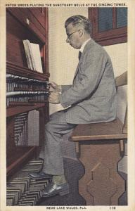 Near LAKE WALES, Florida, 1900-1910's; Anton Brees Playing The Sanctuary Bell...