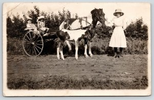 Real Photo Postcard~Big Sis Guides Siblings in Horse Cart~Foal Along~c1915