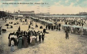 ATLANTIC CITY , New Jersey , 1911 ; Bathing along side the Steeplechase Pier