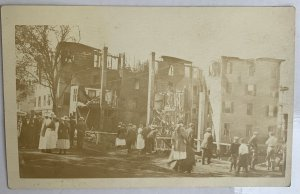 1910-12 building watched demolished/ ruins Many bystanders