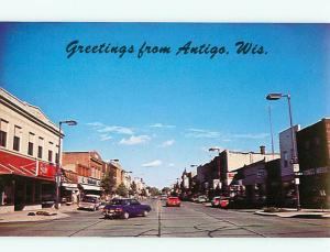 Antigo Wis Street Scene Business Dist Dougs Music Store  Postcard # 8039