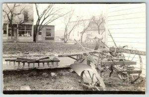 Real Photo Postcard~John Deere Farm Plow & Disc Across From Store~c1920 RPPC