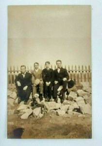 c1907 Men Boys RPPC Postcard Brothers Seated Rocks Picket Fence Suits Hat Bowtie