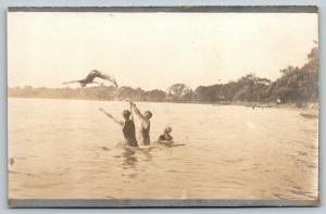 RPPC Do You Got This? Lake Swimmer Eyes Camera As He & Buddy Toss Diver~c1910