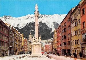 Alpenstadt Innsbruck Maria Theresien Strasse mit Annasaule Winter Tram car