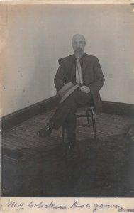 G33/ Red Oak Iowa RPPC Postcard Redoak Man Hat Chair Beard Everett